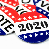 red white and blue buttons with stars that read vote and 2020