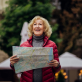 Smiling woman holding a map
